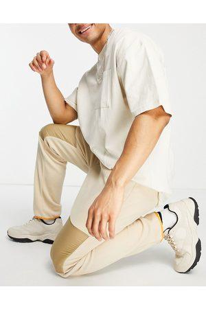 WeSC Polar fleece nylon joggers-Beige