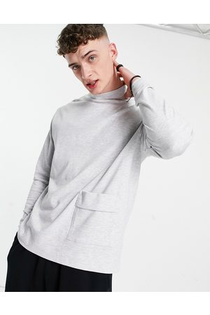 ASOS DESIGN Relaxed long sleeve t-shirt with turtle neck and pocket detail in white marl