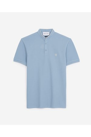 The Kooples Blue officer-collar polo with beige badge