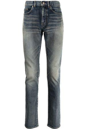 Saint Laurent Whiskered skinny jeans