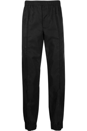 Helmut Lang Logo-print tapered trousers