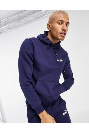 PUMA Essentials hoodie with small logo in navy