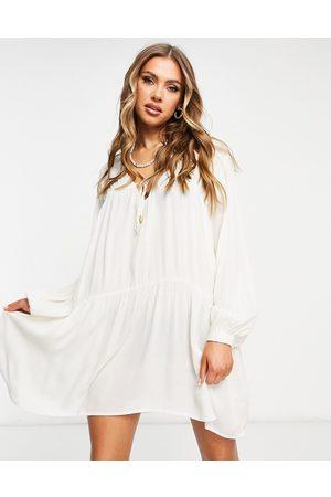 Iisla & Bird Exclusive mini beach swing dress in cream-White