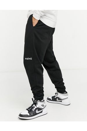 ASOS Co-ord oversized joggers with small city print in black
