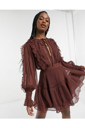 ASOS Lace insert mini dress with ruffle and tie detail in Chocolate-Pink