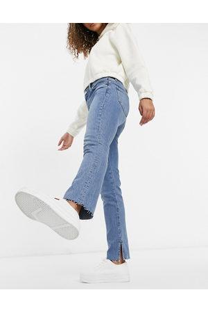ASOS Mid rise vintage 'skinny' jeans in midwash with split hem-Blue