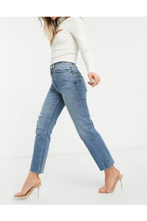 ASOS High rise stretch 'effortless' crop kick flare jeans in midwash with thigh rip-Blue