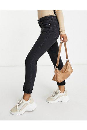 ASOS Mid rise vintage 'skinny' jeans in washed black-Blue
