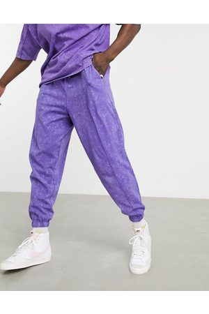ASOS Co-ord oversized lightweight joggers in purple acid wash with seam detail