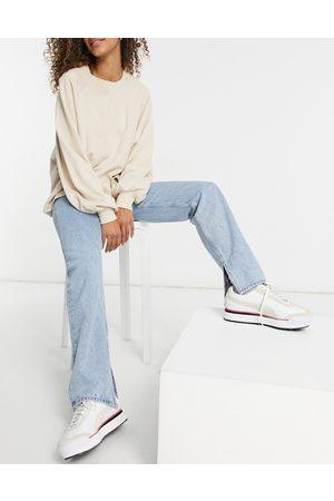 ASOS Mid rise '90s' straight leg jeans in stonewash with split hem-Blue