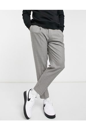 Topman Tapered check trousers in black and white-Brown