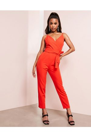 ASOS DESIGN Wrap front jumpsuit with peg leg and self belt in tomato red