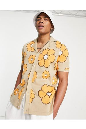 ASOS Knitted polo t-shirt with floral pattern in mustard-Yellow