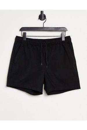 ASOS Slim chino shorts with elastic waist in black