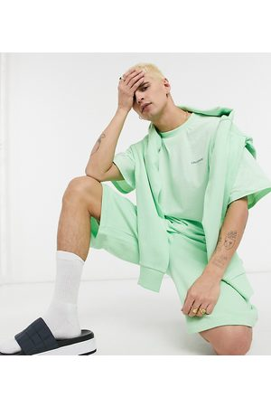 COLLUSION Shorts in green co-ord