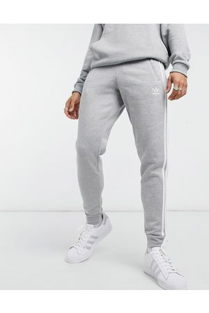 adidas Adicolor three stripe skinny joggers in grey heather