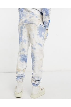 ASOS ASOS Daysocial co-ord jogger in brown and blue tie dye with logo print