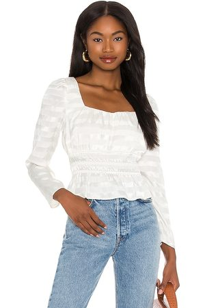 1. STATE Peplum Blouse in - Ivory. Size L (also in XXS, XS, S, M, XL).