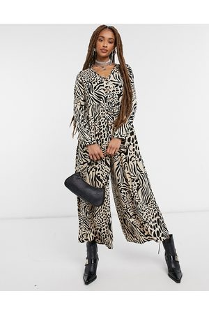 ASOS DESIGN Button front relaxed jumpsuit in animal print-Multi