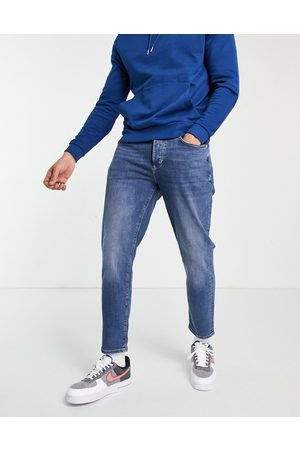 River Island Homem Tapered - Tapered jeans in mid blue
