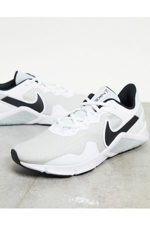 Nike Legend Essential 2 trainers in white