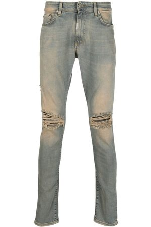Represent Acid-wash distressed jeans