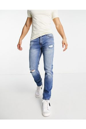 River Island Homem Slim - Slim jeans with rips in light blue