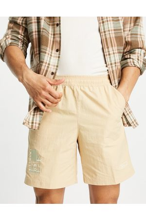 adidas Emblem woven shorts in tan-Brown
