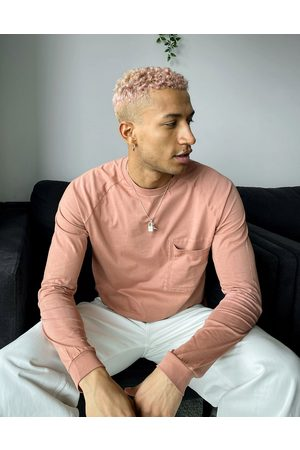 ASOS Relaxed long sleeve t-shirt with pocket detail in washed pink