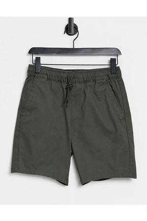 ASOS Slim chino shorts with elasticated waist in khaki-Green