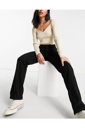 ASOS DESIGN Mid rise '90's' straight leg jeans in black