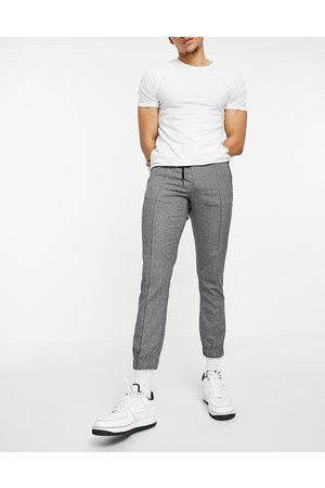 ASOS DESIGN Slim trousers with elasticated waist in textured look grey