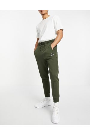 Puma Homem Joggers - Classics Tech sweatpants in forest green