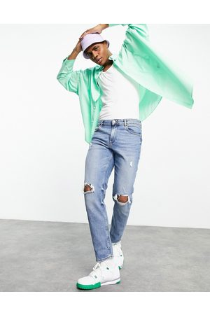 ASOS Homem Tapered - Stretch tapered jeans in tinted mid wash with knee rips-Blue