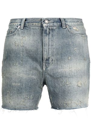 Saint Laurent Homem Calções - Faded distressed denim shorts