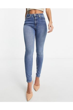 ASOS DESIGN High rise ridley 'skinny' jeans in authentic midwash-Blue