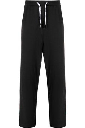 DUOltd Homem Calças - Stripe detail long jogging pants