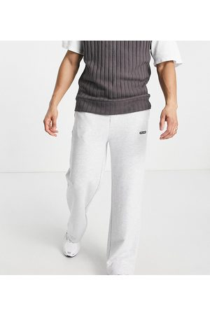 COLLUSION Homem Joggers - Relaxed joggers with logo patch in grey marl co-ord