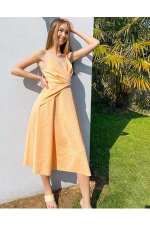 ASOS Senhora Vestidos de Festa - Spaghetti strap wrap tuck midi skater dress in apricot pink-Multi