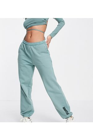 PUMA Joggers - Unisex jogger in washed green - exclusive to ASOS