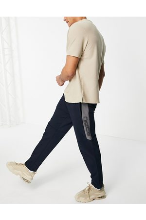 Nicce London Dax mix media tapered joggers in navy