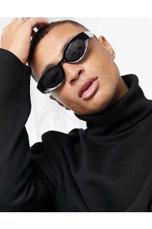 ASOS DESIGN Recycled frame mid oval sunglasses in black with smoke lens