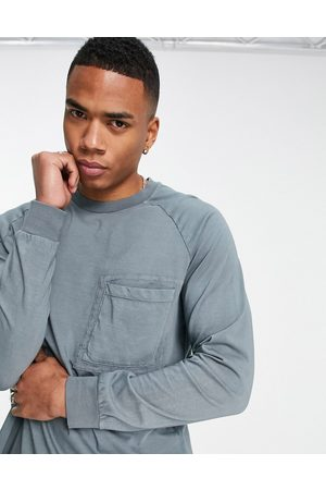 ASOS Relaxed long sleeve t-shirt with pocket detail in grey-Black