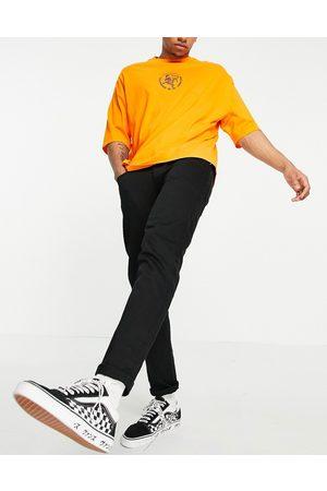 ASOS DESIGN Homem Tapered - No fade black stretch tapered jeans