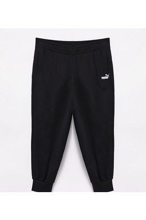 PUMA Plus Essentials joggers in black