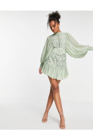 ASOS Lace mini dress with pleated sleeve and belt in sage-Green