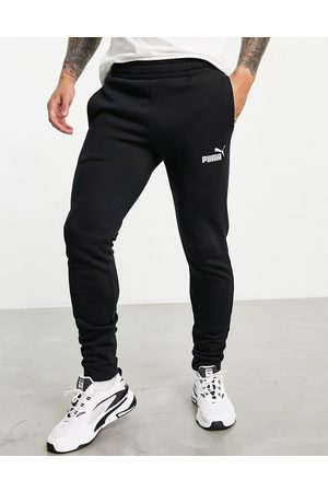 PUMA Clean tracksuit bottoms in black