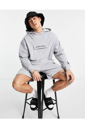 ASOS Co-ord oversized jersey shorts with belt and logo in grey