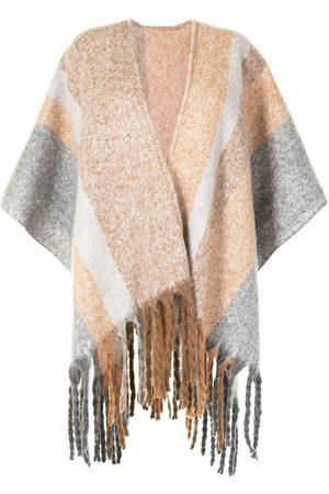 Unreal Fur Ecuador fringed poncho