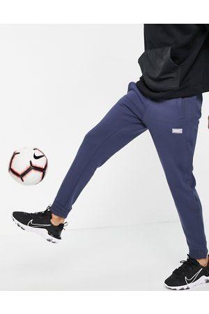 Nike Homem Joggers - Nike FC fleece joggers in blue